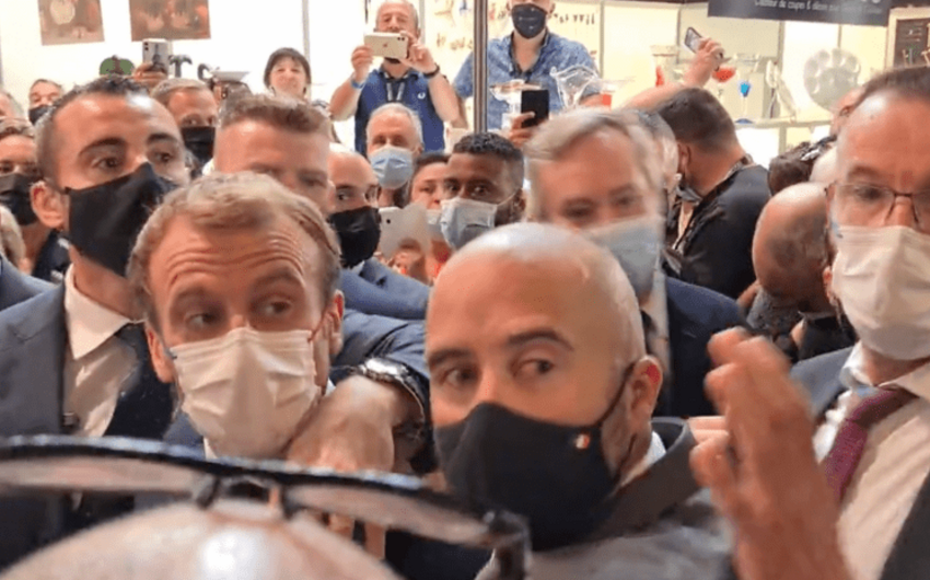 France's Macron hit by egg thrown from crowd in Lyon