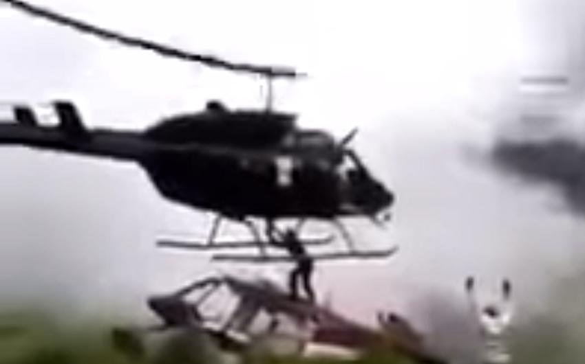 Kolumbiyada vertolyot qəzası yerinə gələn helikopter aviamühəndisin üzərinə düşüb - VİDEO