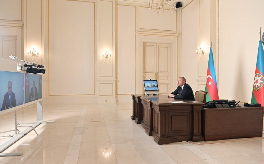 President Ilham Aliyev receives in a video format Anar Karimov