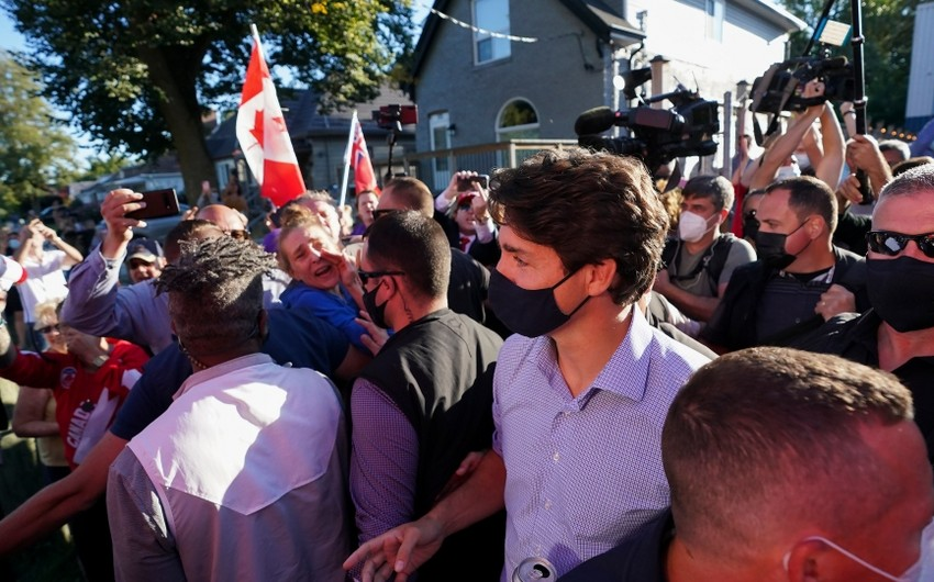 Protesters throw gravel at Canada's PM during pre-election rally