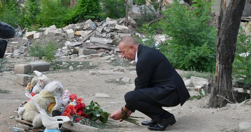 Ilham Aliyev views crime scenes caused by Armenia's missile attacks on Ganja