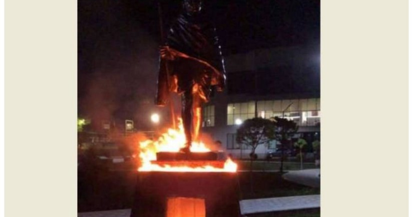 Why was Mahatma Gandhi's statue set on fire in Yerevan?