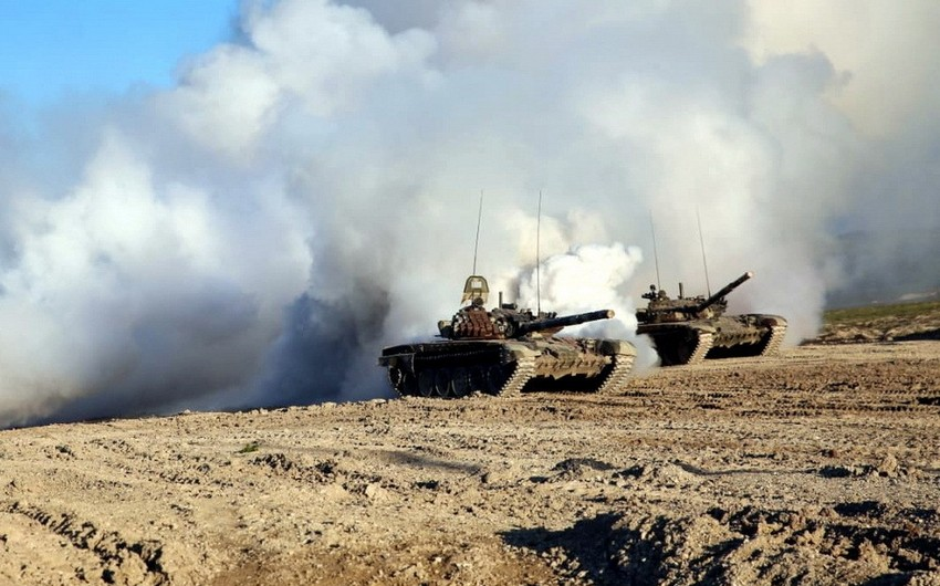 Zakir Hasanov watches live-fire training exercises at the combined-arms range
