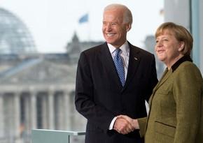 Merkel Baydenlə telefonla danışıb
