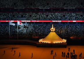 В Токио погас олимпийский огонь