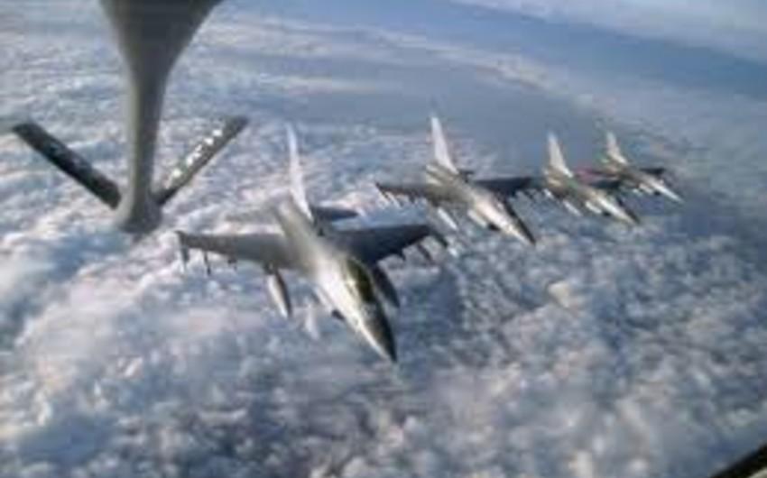 Beynəlxalq koalisiya İŞİD-in mövqelərinə 23 hava zərbəsi endirib