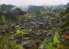В Китае полностью сгорела деревня народности ва