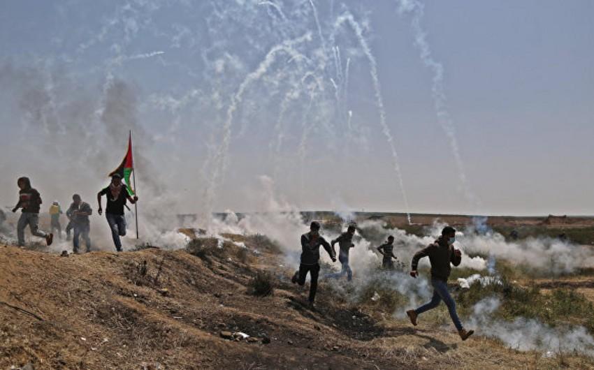 Qəzzada İsrail hərbçiləri ilə toqquşmalarda 1 fələstinli ölüb, 50 nəfər yaralanıb