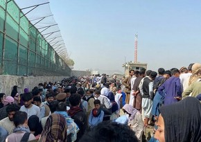 About 1,500 people gather outside Kabul airport to evacuate to US